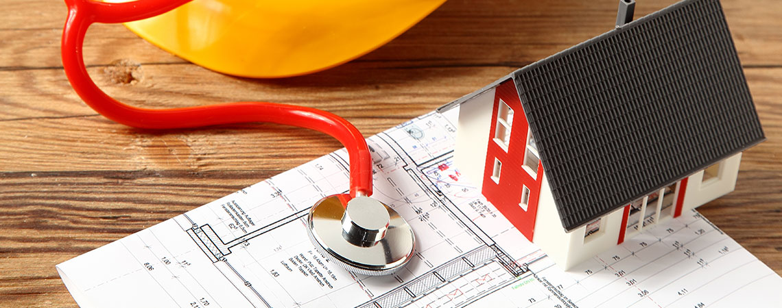 PRE PURCHASE HOUSE INSPECTIONS MELBOURNE - stethoscope on house blueprint